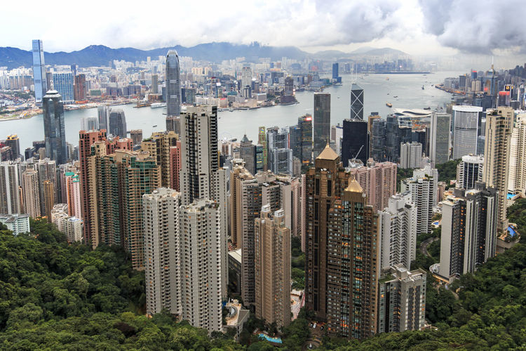 Hong Kong at sunset, from the Victoria Peak Architecture ASIA Building Exterior Built Structure China City City Life Cityscape Cloud - Sky Financial District  Hong Kong Modern Mrt MTR Hong Kong Office Building Outdoors Residential Building Residential District Sky Skyscraper Tall - High Tree Urban Skyline Victoria Harbour Victoria Peak, Hongkong
