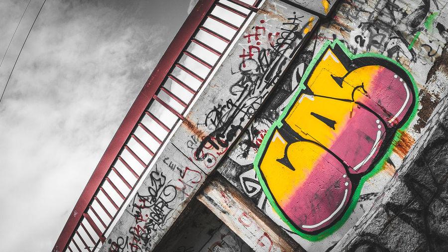 High angle view of graffiti on metal railing