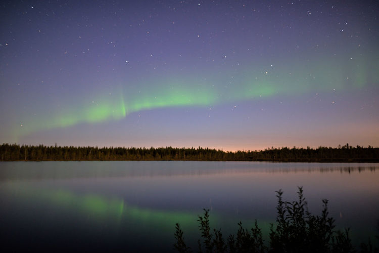 Great start to the autumn Aurora Borealis Finland Lapland Northern Lights Astronomy Beauty In Nature Green Color Idyllic Lake Landscape Nature Nature_collection Night No People Non-urban Scene Photography Purple Reflection Scenics - Nature Sky Star - Space Tranquil Scene Tranquility Tree Water