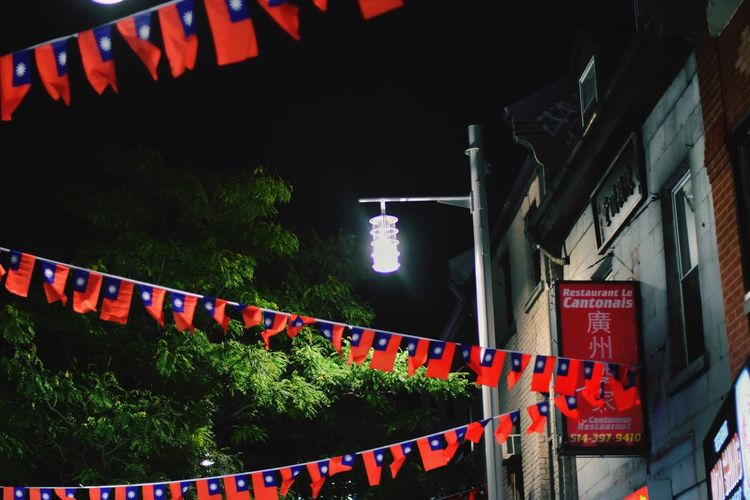Celebration Night Hanging Bunting Outdoors No People Popular Music Concert Sky Yellow Nikonofficals Nikonography City Street Illuminated Paint The Town Yellow The Street Photographer - 2017 EyeEm Awards Architecture Window Montréal HUAWEI Photo Award: After Dark