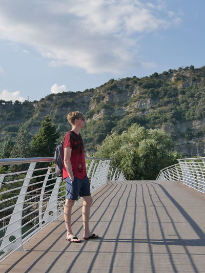 Bridge City Light Day Light And Shadow Man Mountain One Boy Only One Person Outdoors People Real People Shorts Sky Standing