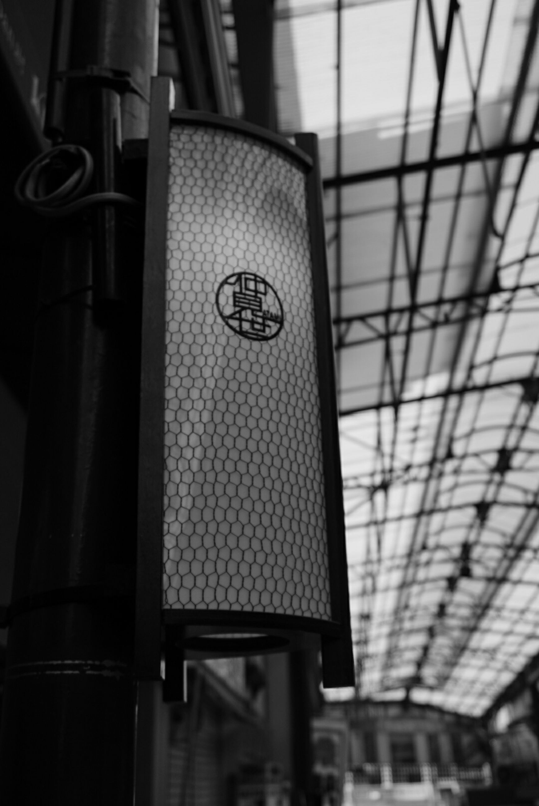 indoors, metal, technology, low angle view, metallic, architecture, built structure, industry, no people, close-up, factory, modern, rail transportation, in a row, public transportation, connection, day, lighting equipment, convenience, selective focus
