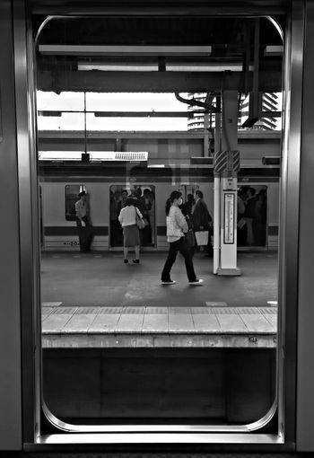 People Waiting At Railroad Station
