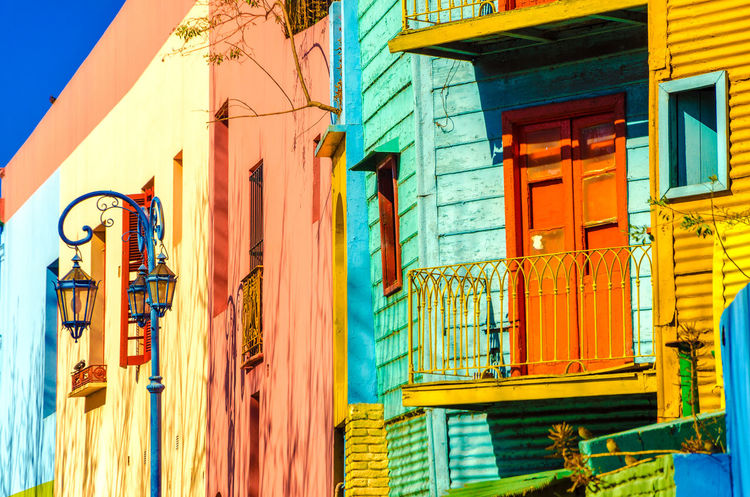 Bright colors of Caminito in La Boca neighborhood of Buenos Aires Architecture Argentina Balconies Balcony Blue Boca Buenos Aires Caminito Colorful Corrugated Green La Boca La Boca, Buenos Aires Landmark Latin Latino Neighborhood Orange Red South America Street Tango Walls Window Yellow