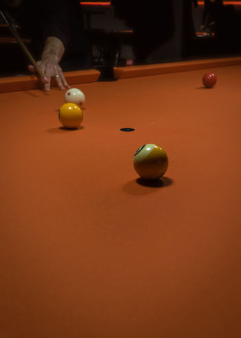 Ball Billiards Close-up Competition Human Hand Indoors  Leisure Activity Leisure Games Nineball One Person Orange Color People Playing Pool - Cue Sport Pool Ball Pool Cue Pool Hall Pool Table Real People Skill  Snooker Snooker And Pool Snooker Ball Sport Table