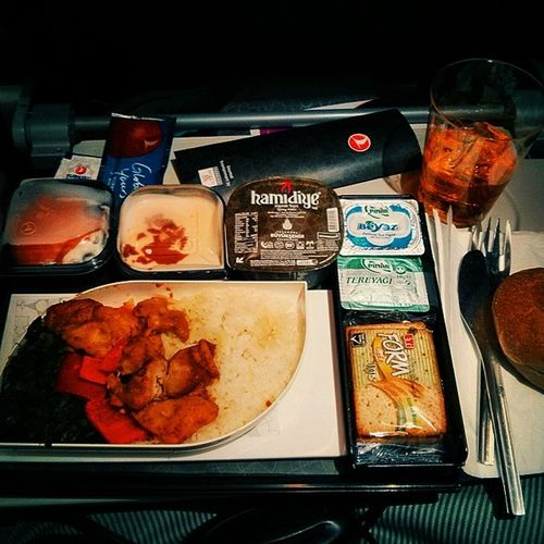 Turkish Airline Delight: Arabic spicy chicken skewer, plain rice and spinach, fresh salmon in green beans and yogurt, oven baked bread and straight bourbon with a side of mint lemonade Perfection AirplaneFood Aircuisine Foodporn drool