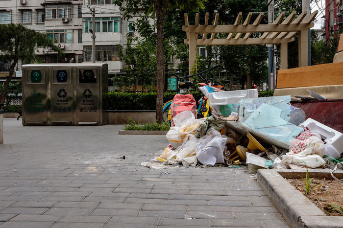 Beijing Discarded Rubbish Trash Architecture Building Exterior Built Structure China City Cleaning Courtyard  Day Environmental Issues Garbage Outdoors Plastic Plastic Bag Social Issues Tree Waste Management