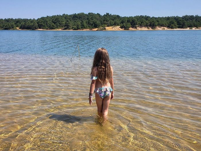 The Great Outdoors - 2018 EyeEm Awards The Traveler - 2018 EyeEm Awards Sun Hair Sea Beach Summer Low Section Women Rear View Sand Long Hair Ankle Deep In Water Wading Shallow Clear Human Back Bikini Calm Shore Back Rippled Bikini Bottom Bikini Top