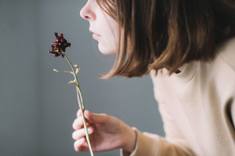 Close-up of girl holding flower