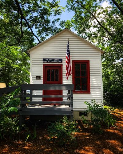 Very small post office Architecture Building Exterior Built Structure Plant Building Tree Flag No People Outdoors Growth Nature Patriotism Day House Communication Front Or Back Yard Red