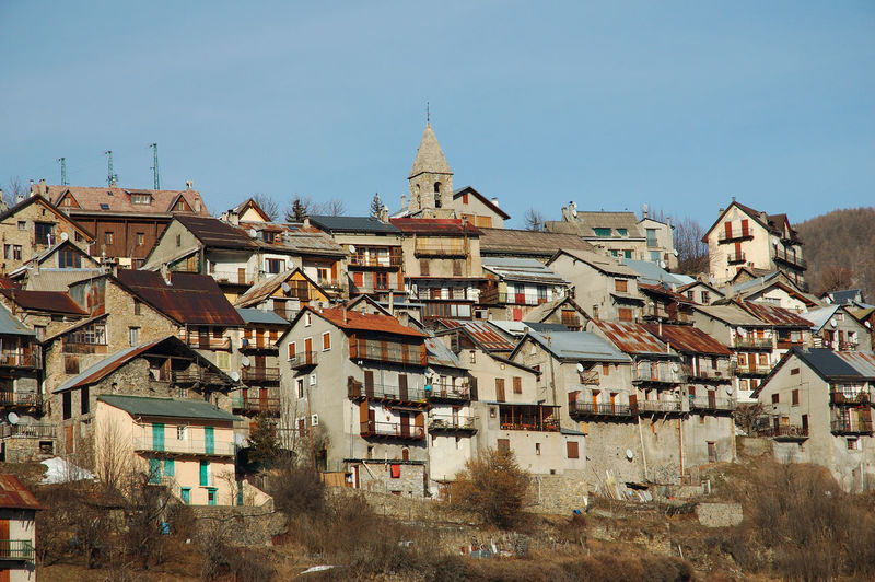 Buildings in town against clear sky