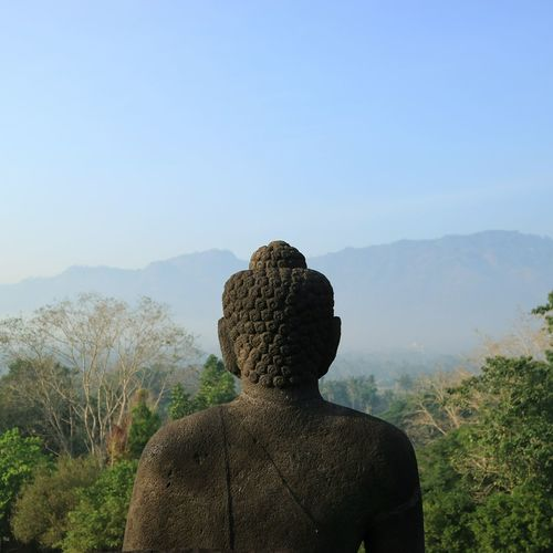 Statue on buddha against clear sky