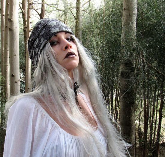 Speaking Through Expressions Beautiful Woman Blond Hair Confidence  Fashion Forest Leisure Activity Lifestyles Long Hair One Person Posing For The Camera Real People Speaking Without Words Standing Tree Warm Clothing White Color Young Women Uniqueness