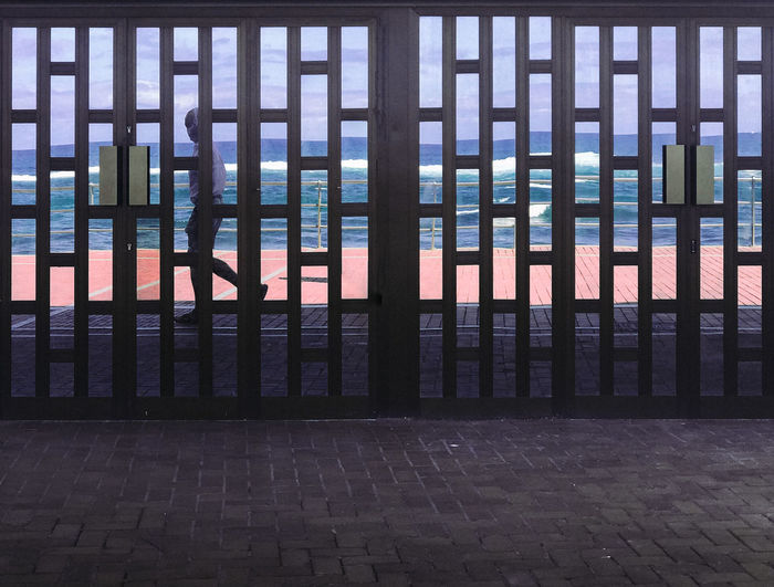 The Graphic City Waves Seascape Sea And Sky Street Photography Streetphotography Architecture_collection Architectural Detail Façade Beachlife Walking Entrance Doors Mirror Reflection Reflection Pattern, Texture, Shape And Form Grid Minimal Architecture Day No People Outdoors Sky Love Yourself