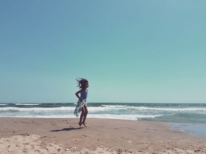 Sea Beach Photography Summer Summer2016 Beauty In Nature SICILY 2016 - Series Sicily Landscape Child At The Beach Jumping Horizon Over Water Sand Full Length Vacations Tranquil Scene Coastline Sky Blue Idyllic Day Enjoyment Peoples And Places People And Places. Mobile Photography Summer Exploratorium