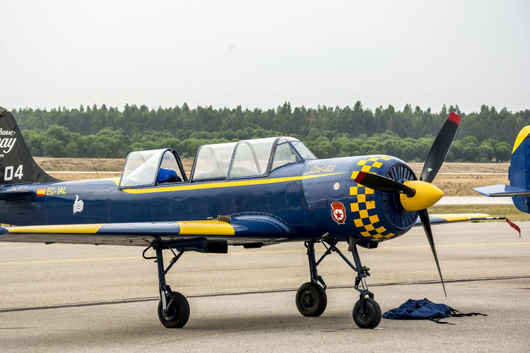 Air show with Yak-52 aircraft in Portugal Aerospace Industry Air Force Air Vehicle Airfield Airplane Airport Runway Airshow Day Fighter Plane History Military Military Airplane No People Old-fashioned Outdoors Pilot Propeller Airplane Retro Styled Stationary Transportation