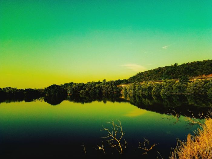 My favorite place to Relax ! Reflection Water Lake Tranquil Scene Nature Green Color Scenics Beauty In Nature No People Tree Tranquility Sunset Outdoors Sky Day