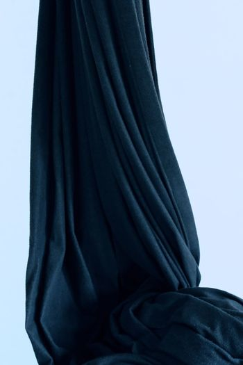 Close-up of man covering face against white background