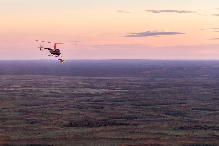 Australia Beauty In Nature Chopper Day Drone  Flying Helicopter Joyride Landscape National Park Nature No People Once In A Lifetime Outback Outdoors Silhouette Sunrise Uluru Vegetation