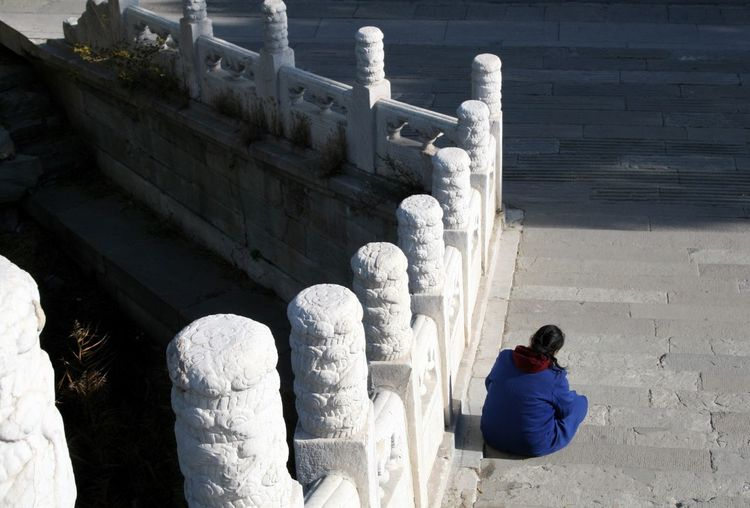 Alone on old steps. One Person Stone Steps Bridge White Stone Blue Clothes One Woman Stone Material Stone Work Real People Outdoors Day Adult Sitting Sitting On Steps Meditation