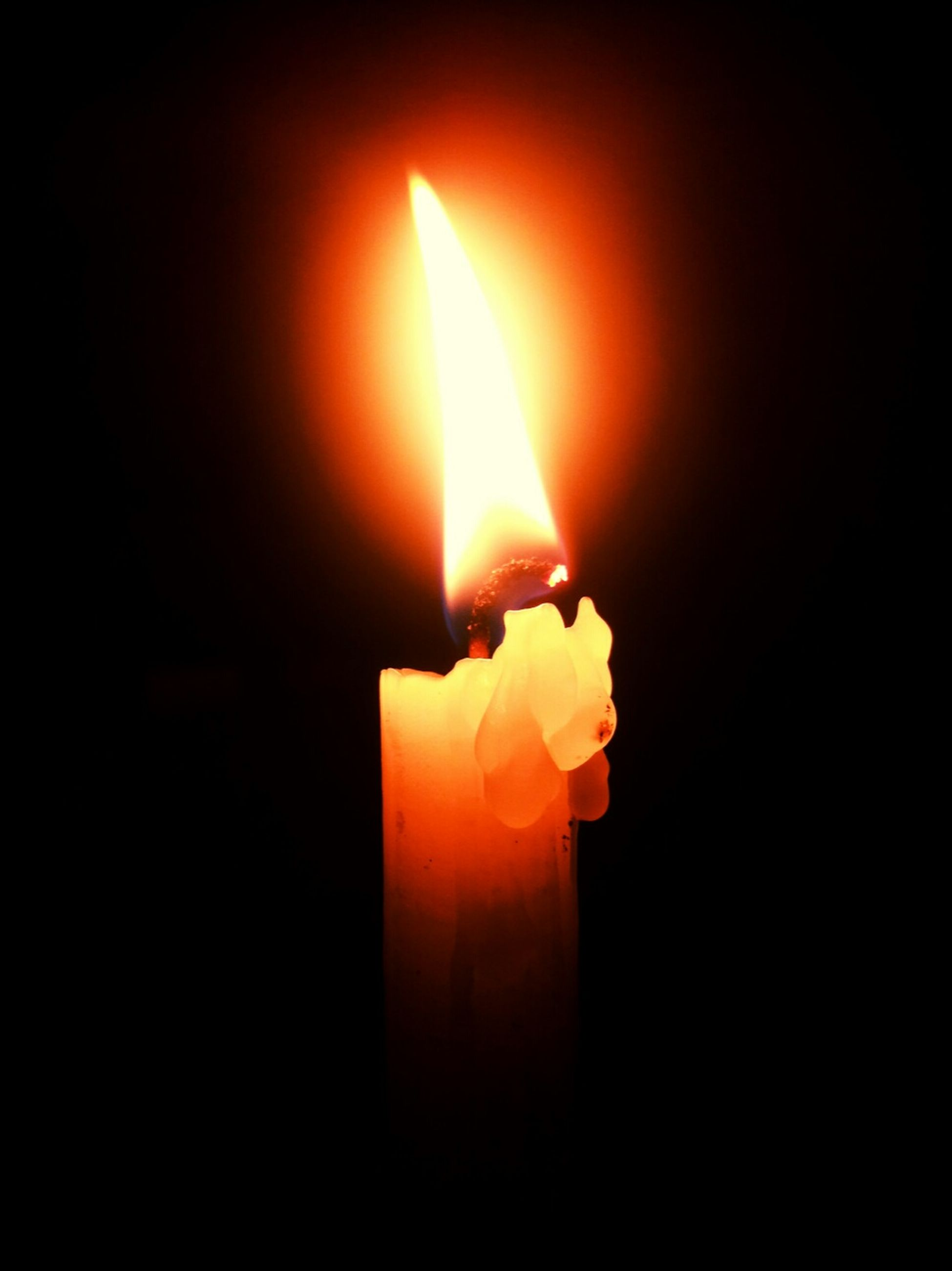 flame, burning, fire - natural phenomenon, heat - temperature, candle, glowing, lit, fire, close-up, indoors, candlelight, dark, illuminated, copy space, orange color, black background, darkroom, studio shot, light - natural phenomenon, heat