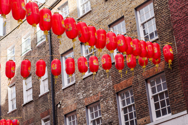 Low angle view of red lanterns hanging on building