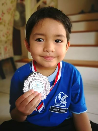 Blue Kindergarten Silvermedal Silver  EyeEm Selects Athlete Portrait Child Childhood Sport Smiling Sports Uniform Looking At Camera AWARD Boys Medal Achievement