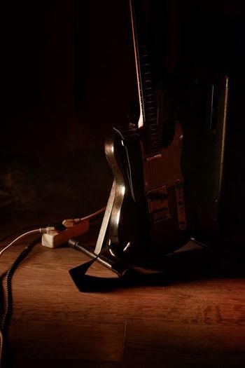 View of guitar at night