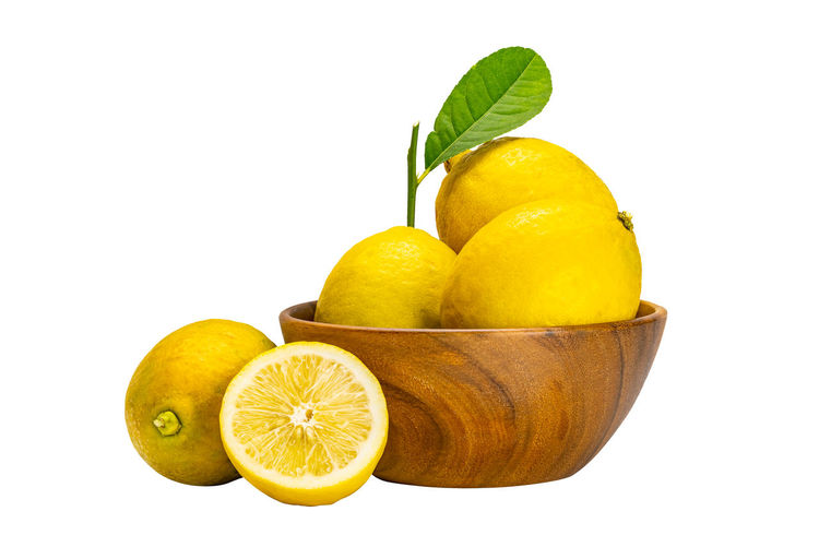 Yellow fruits against white background
