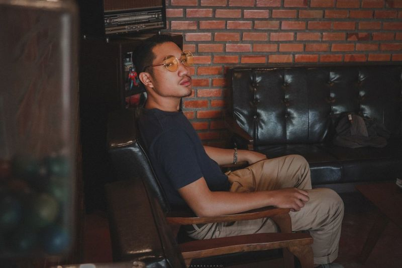 Lonely man and he lifestyle. Vintage Oldschool Old-fashioned Old House Lonelyman Sitting Relaxation Brick Wall Posing Happy Hour