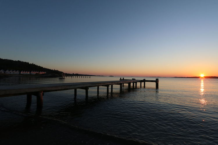 Askims Beach Sky Water Sunset Tranquility Beauty In Nature Scenics - Nature Tranquil Scene Nature Clear Sky Copy Space Pier No People Reflection Sea Waterfront Outdoors Idyllic Architecture