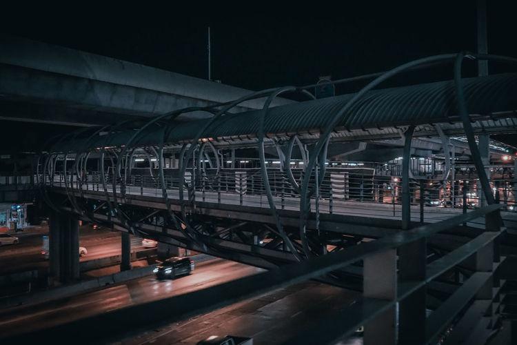 Bridge over illuminated city at night