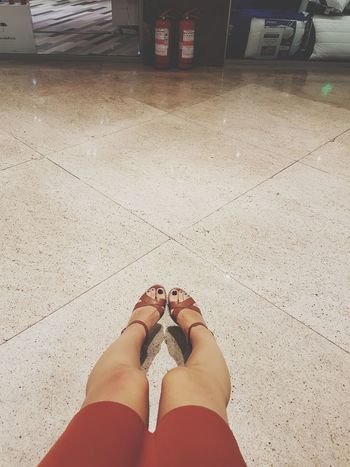 Human Leg Human Body Part Real People Feet Feetselfie Feet And Shoes Sandals Fire Extinguishers Tired Tired Feet Walking All Day Taking A Break Legs Legs And Feet Legsselfie PhonePhotography EyeEmNewHere My Feet Hurt !! My Feet Are Awesome Low Section Shoppping Tanned Legs Summer Women Marble Floors Neon Life Stories From The City