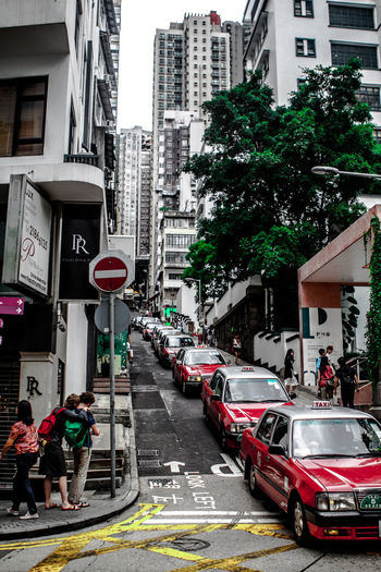 Architecture Built Structure City City City Life City Street Day Downtown Hong Kong Land Vehicle Mode Of Transport Outdoors Road Taxi The 2016 EyeEm Awards The Great Outdoors - 2016 EyeEm Awards MyCommute My Commute