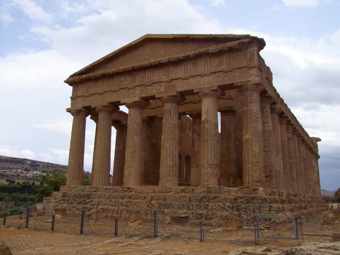 Doric Temple of Concord (5th Century BC) 5th Century BC Agrigento Ancient Civilization Blue Sky White Clouds Columns Composition Culture DORIC BUILDING Historic History Italy No People Perspective Religion Ruined Sicily Temple Tourist Attraction