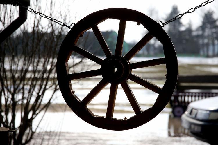 Close-up of ferris wheel against river