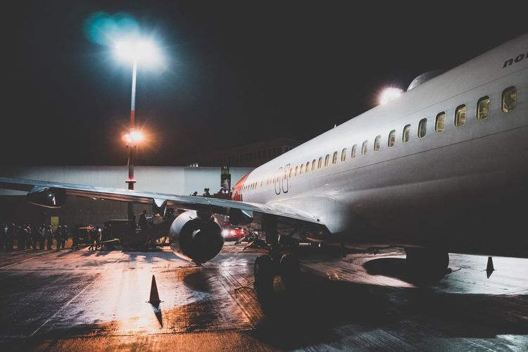 Plane boarding at Night Onboarding Night Shot Airplane Transportation Mode Of Transport Airport Air Vehicle Airport Runway Night Commercial Airplane Illuminated No People Runway Outdoors Aerospace Industry Sky