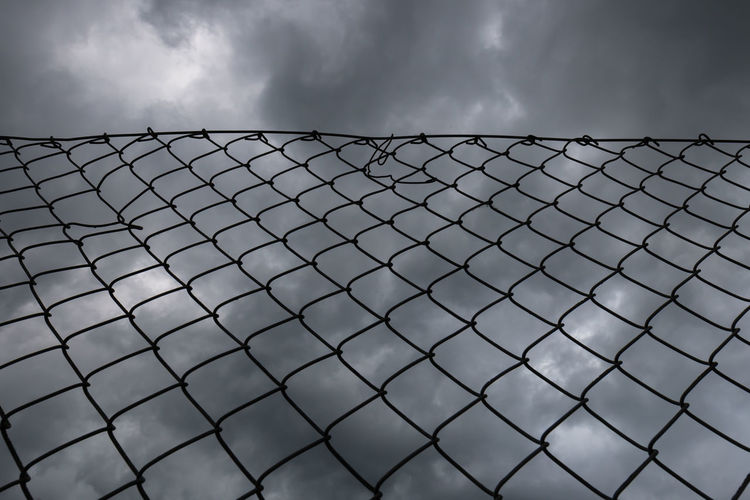 A thunderstorm is approaching. Chainlink Fence Close-up Cloud - Sky Day Low Angle View Metal Nature No People Nusshain 06 17 Outdoors Pattern Protection Safety Security Sky Storm Cloud Black And White Friday