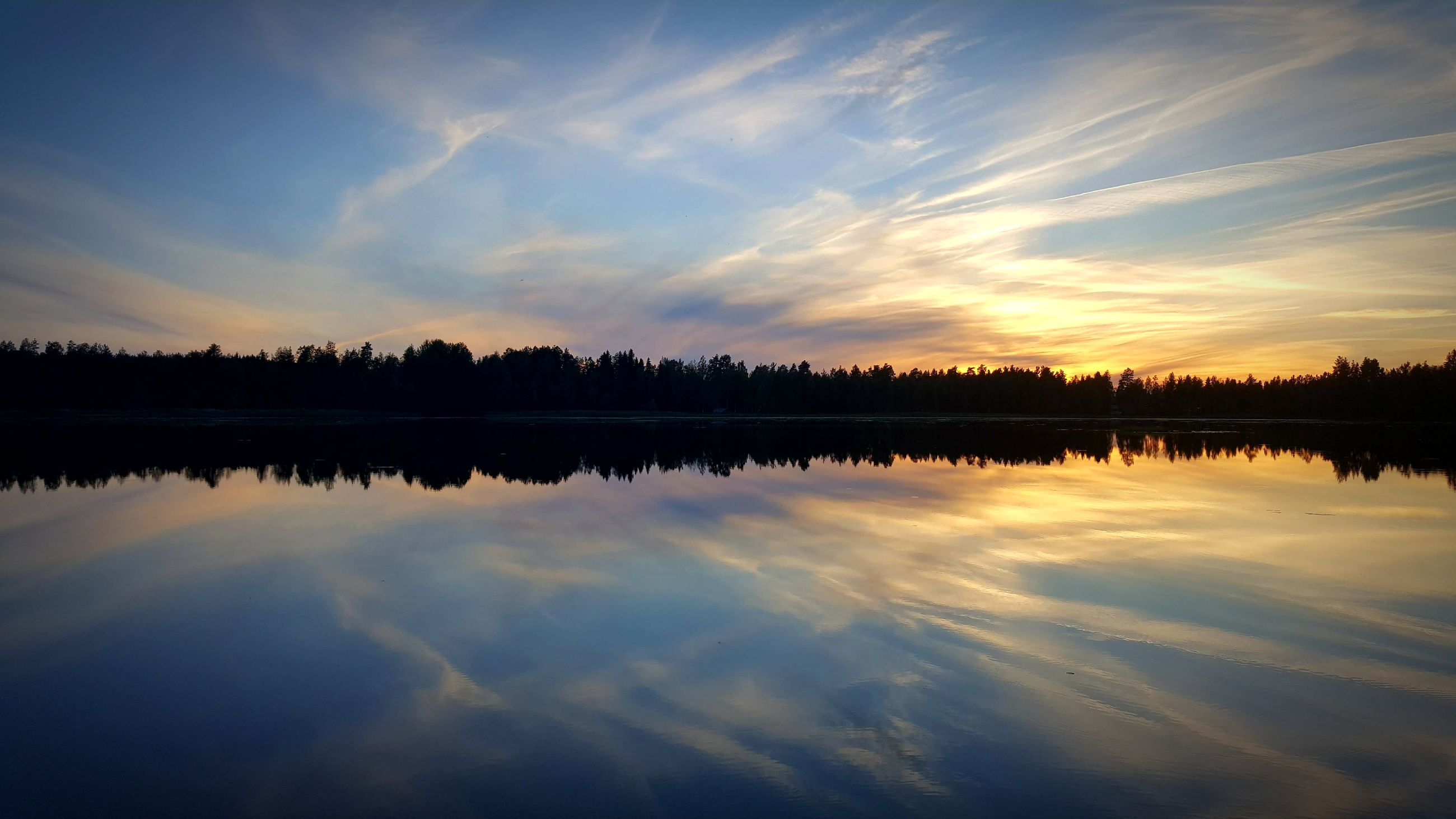 reflection, water, sunset, sky, lake, beauty in nature, nature, silhouette, tranquil scene, cloud - sky, scenics, tranquility, standing water, no people, waterfront, outdoors, tree, symmetry, day