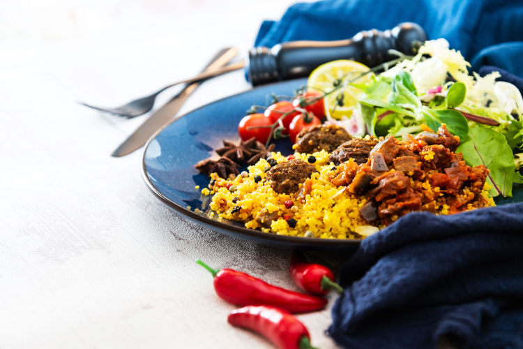 Food And Drink Close-up Day Eating Utensil Finger Focus On Foreground Food Food And Drink Freshness Hand Healthy Eating Human Body Part Human Hand Indoors  Kitchen Utensil One Person Plate Ready-to-eat Real People Selective Focus Table Vegetable