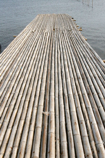 Wooden raft floating on lake