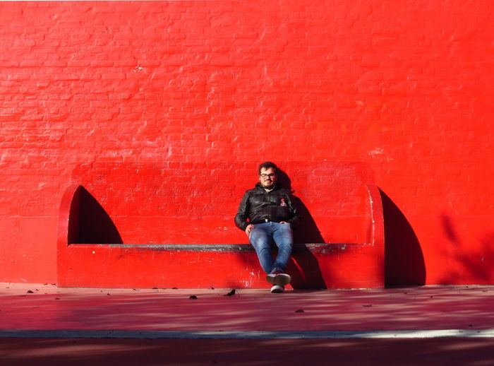 One Person Red Casual Clothing Lifestyles Front View Young Adult Leisure Activity Real People Wall - Building Feature Contemplation Bench Chilling Chill Copenhagen Sitting Enjoying The Sun Sunbathing Zen Relaxing Relaxation Relaxing Moments City Life Urban Lifestyle Eyes Closed  Contemplation Springtime Decadence