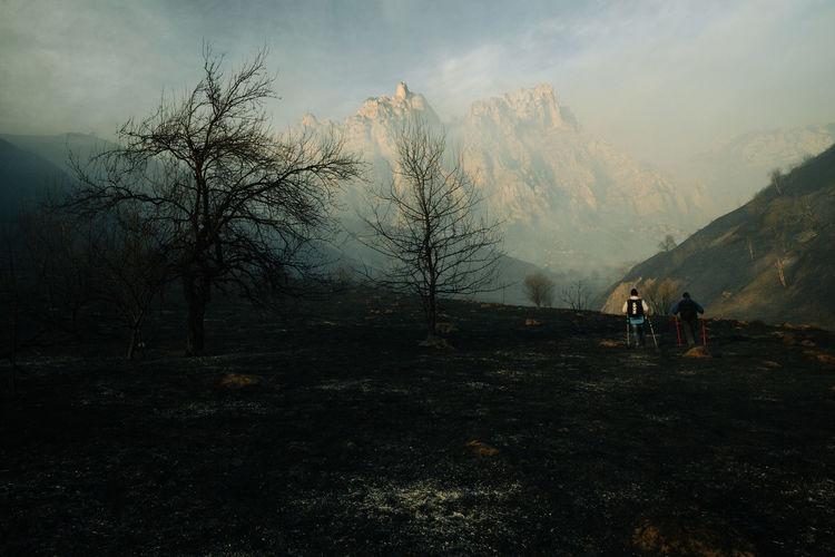 People on land against sky