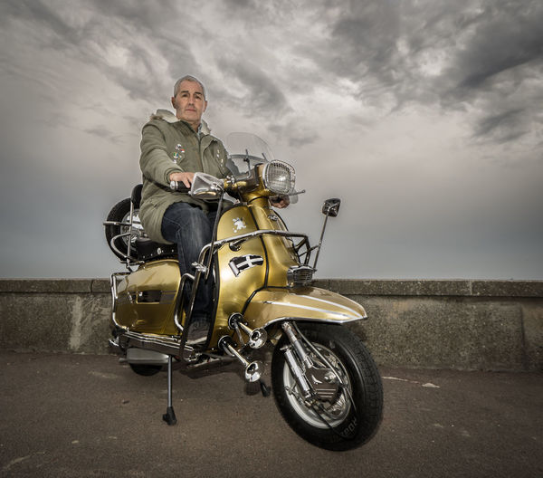 Mods Retro Southend On Sea Adult Adults Only Beach Casual Clothing Cloud - Sky Day Full Length Headwear Lifestyles Looking At Camera Mature Adult Mature Men Men Mods Scooters Motorcycle One Man Only One Person Only Men Outdoors People Portrait Real People Sitting Sky Smiling Transportation Vintage