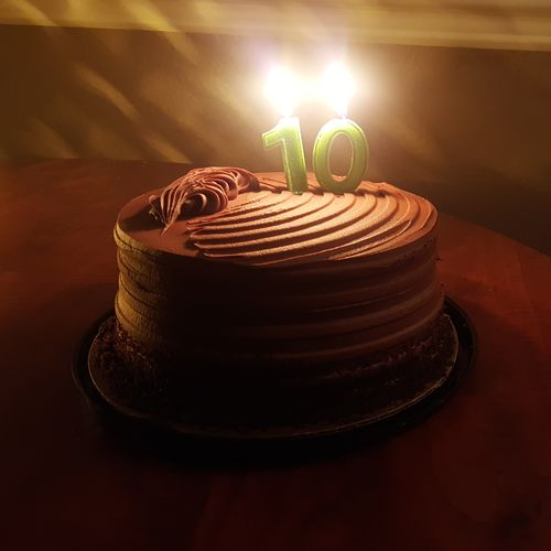 Close-up of cake on illuminated table
