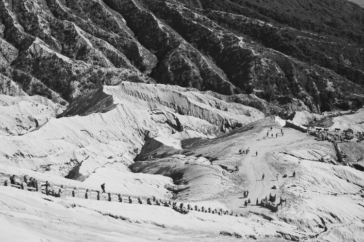 Distant View Of People On Dirt Road At Mt Bromo