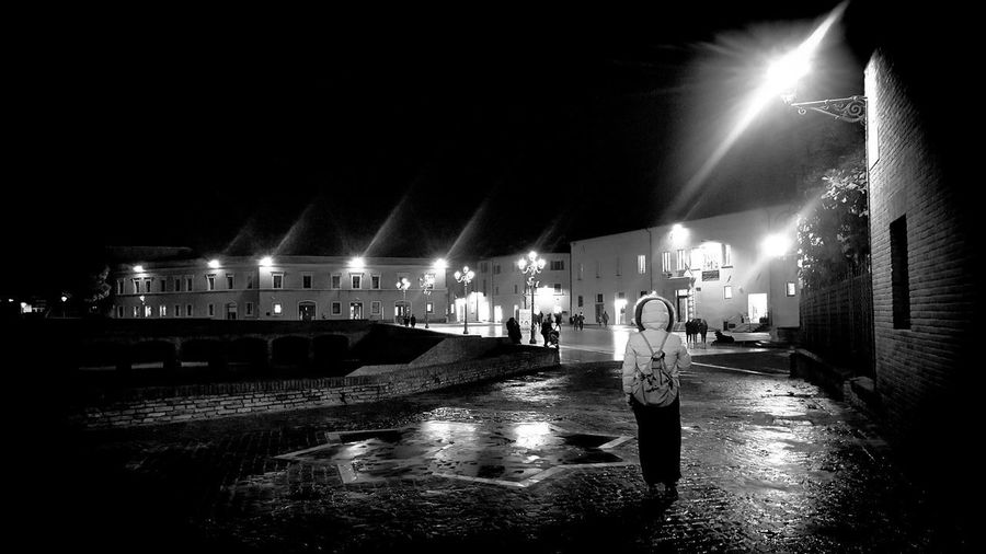 A woman wears jacket on a winter raining day of November and walks alone at Senigallia, Italy 26l5 november 2018 Streetphotography Raining Raining Day Italy❤️ Italy Marche Marche Region Landscape_Collection Street Photography Street Event Blackandwhite Woman Woman Walking Woman Walking On The Street Raining Day Popular Music Concert Crowd Illuminated Nightlife Arts Culture And Entertainment Music Stage - Performance Space Performance Light Beam Audience Live Event