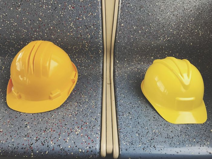 Close-up and high angle view of hardhats