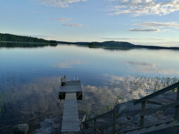Lakeside view at friends house 😊Water Reflection Lake No People Outdoors Tranquility Day Nature Sky Lakesideview Landscapes Finnish  Reflection Photographer Summernight Nature Summer Beauty In Nature Finnishboy