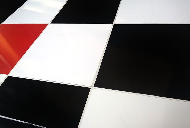 Checkered tile wall. Empty Absence No People Diamond Seperated Diagonal Grout Slanted Squares Wall Black And White Red Tiles Chess Board Close-up Geometric Shape Rectangle Checked Pattern Square Shape Grid Chess Full Frame Backgrounds Textured